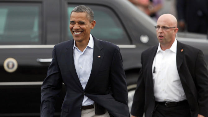 President Barack Obama walks over to greet supporters after arriving at Toledo Express Airport in Swanton, Ohio, Sunday, Sept. 2, 2012. (AP Photo/Madalyn Ruggiero)