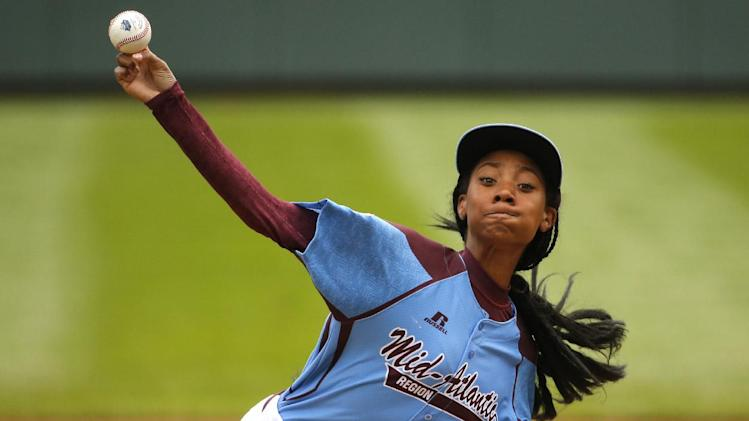 FILE - In this Aug. 15, 2014, file photo, Pennsylvania's Mo'ne Davis delivers in the first inning against Tennessee during a baseball game in United States pool play at the Little League World Series tournament in South Williamsport, Pa. The Little League sensation is heading to the WNBA conference finals in Minnesota on Sunday, Aug. 31. She'll sit with WNBA president Laurel J. Richie and meet both teams, including former UConn stars Diana Taurasi and Maya Moore before the game starts. (AP Photo/Gene J. Puskar, File)