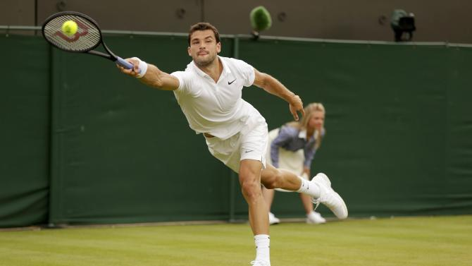 Grigor Dimitrov of Bulgaria hits a shot during his match against Steve Johnson of the U.S.A. at the Wimbledon Tennis Championships in London