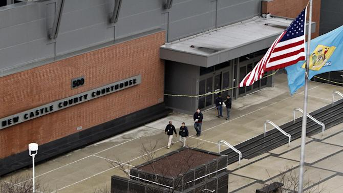 Law enforcement officials and investigators gather outside the New Castle County Courthouse in Wilmington, Del. on Monday, Feb. 11, 2013, after three people died Monday morning in a shooting at a courthouse, including the shooter, authorities said.  (AP Photo/ Joseph Kaczmarek)