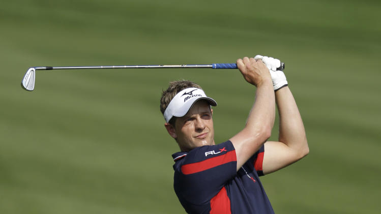 England's Luke Donald plays a ball on the 2nd hole during the final round of the Dubai World Championship golf tournament on Sunday, Dec. 11, 2011 in Dubai, United Arab Emirates. (AP Photo/Kamran Jebreili)