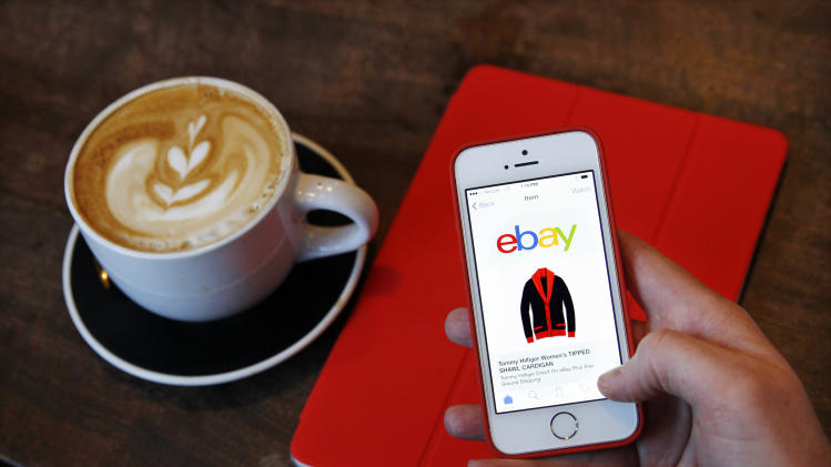 IMAGE DISTRIBUTED FOR EBAY - The busiest mobile shopping day on eBay in the U.S. was Sunday, December 15. Sunday's have been the most popular day for iOS users to shop on eBay with the most popular categories being Fashion, Collectibles, and Electronics. (Photo by Paul Sakuma Photography/eBay via AP Images)