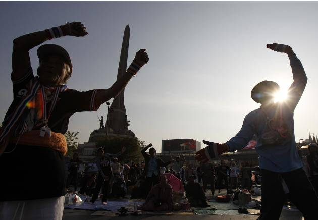 Anti-government protesters exercise as they take part in a rally at the Victory Monument in Bangkok