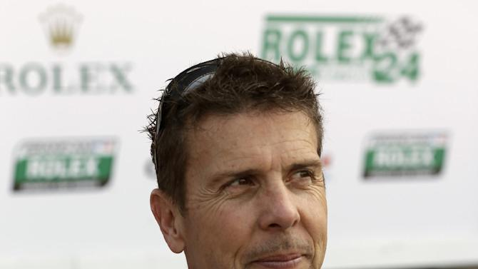 Scott Pruett, the pole-sitter for the Rolex 24 hour auto race  talks with members of the media after the final practice at Daytona International Speedway, Friday, Jan. 25, 2013, in Daytona Beach, Fla. (AP Photo/John Raoux)