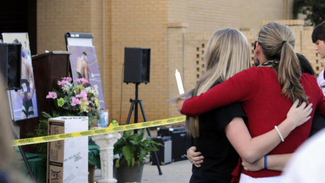 A vigil is held to remember former Wetupmka student and wrester Gilbert Collar on Tuesday, Oct. 9, 2012, at the high school in Wetumpka, Ala. Collar was shot and killed by a University of South Alabama police officer on Oct. 6. Mobile County Sheriff Sam Cochran said at a news conference that 18-year-old Gilbert Collar, who was nude at the time he was shot, took the potent hallucinogen during a music festival Saturday before assaulting two people in vehicles and attempting to bite a woman's arm. (AP Photo/Montgomery Advertiser, Amanda Sowards)