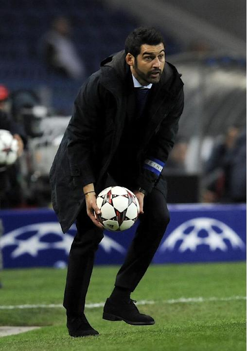 Porto's coach Paulo Fonseca catches a ball on the touchline during the Champions League group G soccer match between FC Porto and Austria Vienna Tuesday, Nov. 26, 2013, at the Dragao stadium in Porto,