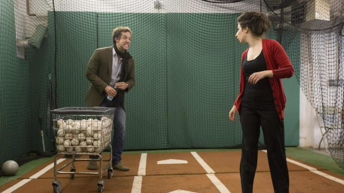 """Actors Peter Cambor and Jenna Augen rehearse their lines in the Red Sox batting cage during the Commonwealth Shakespeare Company's production """"Shakespeare at Fenway"""" at Fenway Park in Boston"""