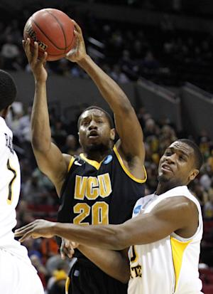 Virginia Commenwealth's Bradford Burgess (20) shoots against Wichita State's Ben Smith during the first half of an NCAA tournament second-round college basketball game in Portland, Ore., Thursday, March 15, 2012. (AP Photo/Rick Bowmer)