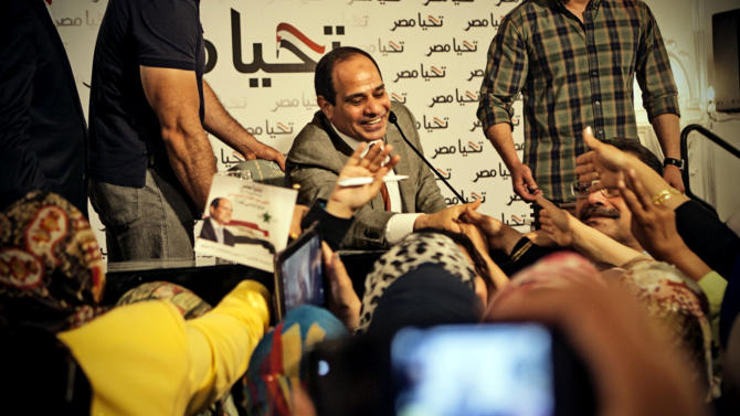 This Monday, May 5, 2014 photo released by the presidential campaign of Abdel-Fattah el-Sissi shows the candidate greeting supporters at a gathering of some 600 women in Cairo, Egypt. El-Sisi acknowledged the importance of Egyptian women in shaping the nation's history and building the nation's future according to campaign officials. (AP Photo/El-Sissi for President)