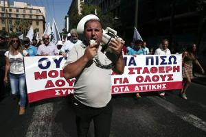 Protesters shout slogans as they march towards the parliament during the first day of a 48-hour strike by public sector workers in Athens
