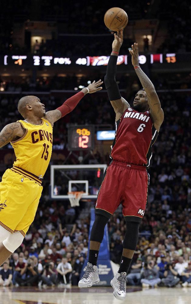 Miami Heat's LeBron James (6) shoots over Cleveland Cavalier's Marreese Speights (15) during the fourth quarter of an NBA basketball game Wednesday, March 20, 2013, in Cleveland. James scored a team-high 25 points in Miami's 98-95 win. (AP Photo/Tony Dejak)