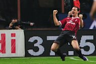 AC Milan's Swedish forward Zlatan Ibrahimovic celebrates after scoring against Roma at the San Siro in Milan on Saturday