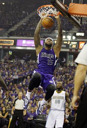 Kings beat Nuggets 90-88 in celebratory opener
