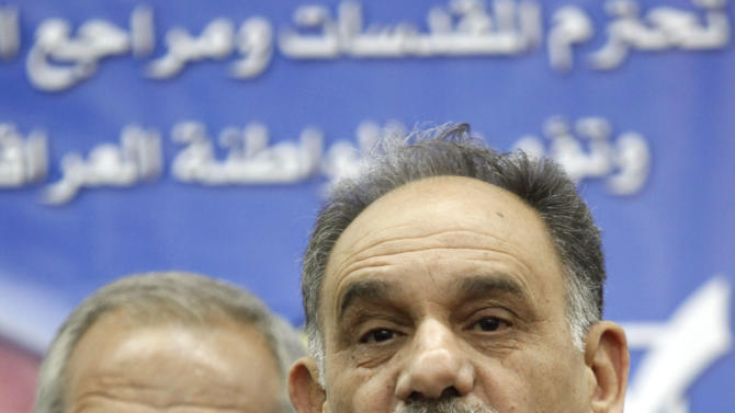 FILE - In this Feb. 25, 2010, file photo, Iraq's Deputy Prime Minister Saleh al-Mutlaq, right, speaks to reporters in Baghdad, Iraq. Bodyguards for a senior Iraqi Sunni politician wounded two people while shooting to disperse angry anti-government protesters in Iraq's west, a provincial official said. It is the first significant incident of violence reported during more than a week of protests by Sunnis angry over their perceived second-class treatment by the country's Shiite-led government. (AP Photo/Hadi Mizban, File)