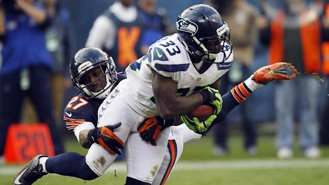 Seattle Seahawks running back Leon Washington (33) is tackled by Chicago Bears defensive back Sherrick McManis (27) in the second half of an NFL football game in Chicago, Sunday, Dec. 2, 2012. (AP Photo/Charles Rex Arbogast)