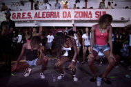 In this Feb. 3, 2012, women dance during a funk &quot;baile,&quot; or party, in the Cantagalo slum in Rio de Janeiro, Brazil. Its market potential has become hard to ignore: A recent survey by the Brazilian think tank the Getulio Vargas Foundation found funk disc jockeys, MCs and others generate about $720 million a month in revenue. (AP Photo/Felipe Dana)