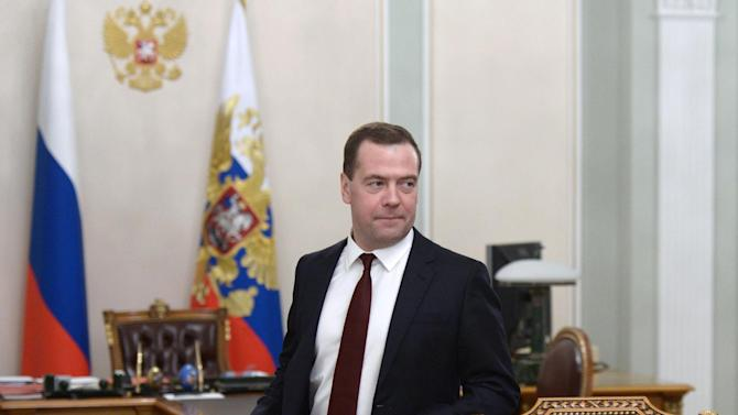 Russian Prime Minister Dmitry Medvedev arrived to attend a cabinet meeting chaired by President Vladimir Putin in Novo-Ogaryovo outside Moscow, Russia, Monday, Jan. 26, 2015. The meeting focused on the government's anti-crisis plan. (AP Photo/RIA-Novosti, Alexei Nikolsky, Presidential Press Service)