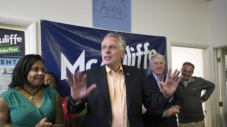 Virginia gubernatorial candidate Terry McAuliffe, center, speaks to his supporters and encourages them to make the final push by knocking on door-to-door to get more votes on Saturday, Nov. 2, 2013, in Norfolk, Va. (AP Photo/The Virginian-Pilot, The' N. Pham) MAGS OUT