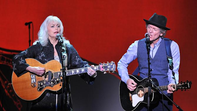 """Musicians Emmy Lou Harris, left, and Rodney Crowell perform at """"Play It Forward: A Celebration of Music's Evolution and Influencers"""" at the Grammy Foundation's 15th Annual Music Preservation Project, Thursday, Feb. 7, 2013, in Los Angeles. (Photo by Vince Bucci/Invision/AP)"""