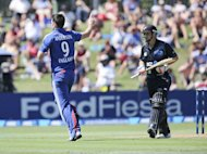 James Anderson (left) of England celebrates the wicket of BJ Watling of New Zealand during their second one-day match at McLean Park in Napier on February 20, 2013. A five-wicket haul by James Anderson backed by a dominant England batting display set up an eight-wicket win over New Zealand in the second one-day international in Napier