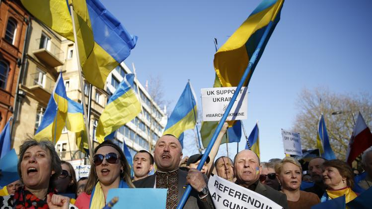 Demonstrators protest against the referendum in Crimea, outside the Russian embassy in central London