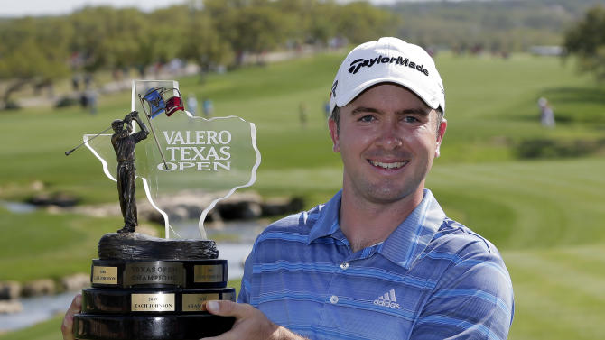 Martin Laird, of Scotland, poses with his trophy after winning  the Texas Open golf tournament, Sunday, April 7, 2013, in San Antonio.  (AP Photo/Eric Gay)