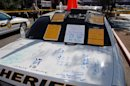 In this image released by the Pima County Sheriff's department, police notes are seen scrawled on the trunk of a police car, in the aftermath of the Tucson shooting rampage that killed six people and wounded former U.S. Rep. Gabrielle Giffords and 12 others in January 2011. Authorities released more than 300 photos on Tuesday, May 21, 2013, made by investigators during their investigation in the parking lot of the shopping center where the shooting took place. (AP Photo/Pima County Sheriff)