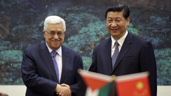 China's President Xi Jinping, right, shakes hands with his Palestinian counterpart Mahmoud Abbas during a signing ceremony at the Great Hall of the People in Beijing, China Monday, May 6, 2013. (AP Photo/Jason Lee, Pool)