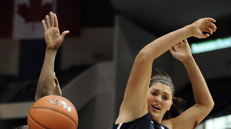 Connecticut's Stefanie Dolson top battle for a rebound with Notre Dame's Skylar Diggins, bottom, and Notre Dame's Markisha Wright, left, in the second half of an NCAA college basketball game in the final of the Big East Conference women's tournament in Hartford, Conn., Tuesday, March 12, 2013. (AP Photo/Jessica Hill)