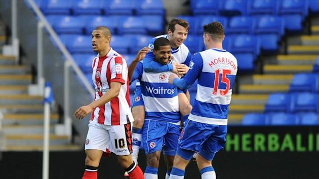 Reading's Mikele Leigertwood (centre) celebrates after scoring his side's second goal