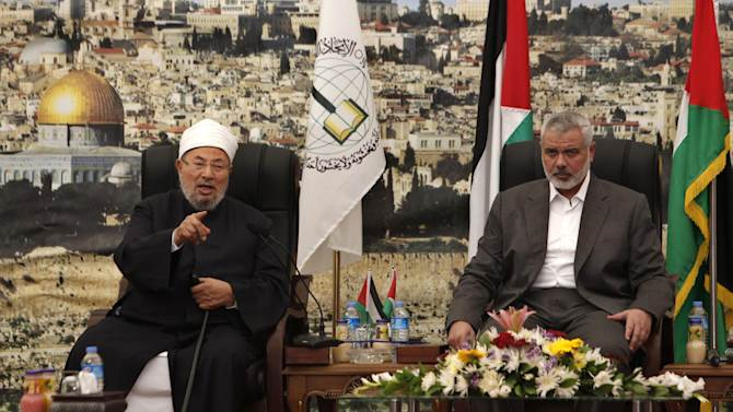 """Influential Muslim cleric Yusuf al-Qaradawi, left, talks as Gaza's Hamas Prime Minister Ismail Haniyeh listens, during their meeting in Gaza City, Thursday, May 9, 2013. al-Qaradawi has declared that Israel has no right to exist on Thursday and said that """"this land has never once been a Jewish land. Palestine is for the Arab Islamic nation."""" The Qatar-based cleric hosts a popular TV show and is widely respected in the Muslim world. (AP Photo/Adel Hana)"""