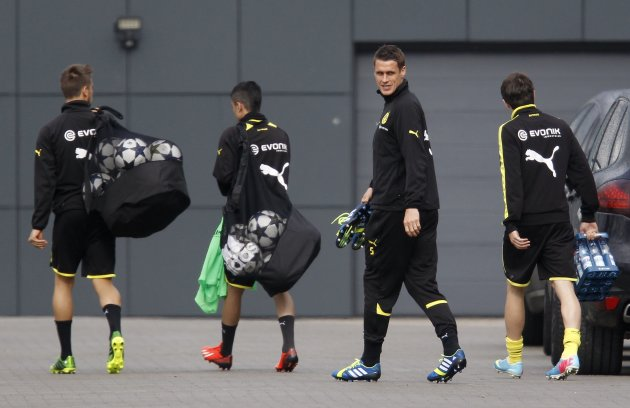 Borussia Dortmund's Kehl and team mates arrive for a training session in Dortmund