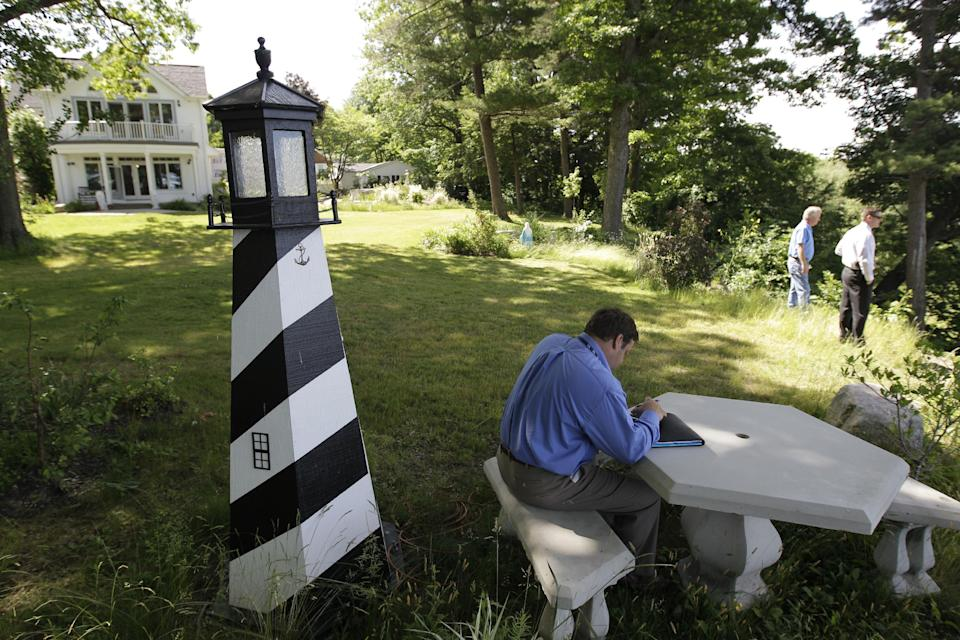 A Law enforcement officer takes notes at the home of Dr. Timothy Jorden in Hamburg, N.Y., Thursday, June 14, 2012. Jorden is sought in connection with the hospital shooting death of his ex-girlfriend at Erie County Medical Center in Buffalo, N.Y. on Wednesday.  (AP Photo/David Duprey)