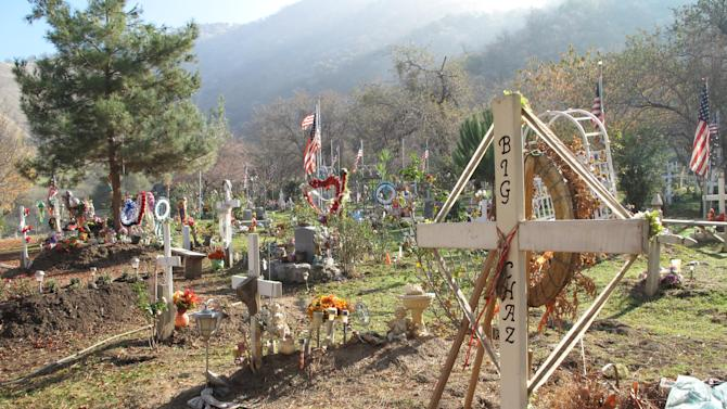 """Shown is the Tule River Indian Reservation's """"lower"""" cemetery, one of two, where 8-year-old Alyssa Celaya's grave was to be dug on Monday Dec. 10, 2012. Authorities are piecing together what led a man to kill his mother and two uncles, and shoot his three children before being killed in a shootout with police on Saturday. The violence shook the tiny Tule River Indian Reservation, home to 800 residents. (AP Photo/Tracie Cone)"""