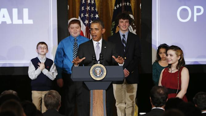 President Barack Obama speaks at the first White House Student Film Festival, Friday, Feb. 28, 2014, in the East Room at the White House in Washington. Student filmmakers pictured, Miles Pilchik, left, and Gabrielle Nafie, second right, second graders, SciTech in New York, Kids; Kyle Weintraub, second left, seventh grade, from David Posnack Jewish Day School in Davie, Fla.; and Shelly Ortiz, high school senior at Metropolitan Arts Institute, from Phoenix, Ariz. (AP Photo/Charles Dharapak)