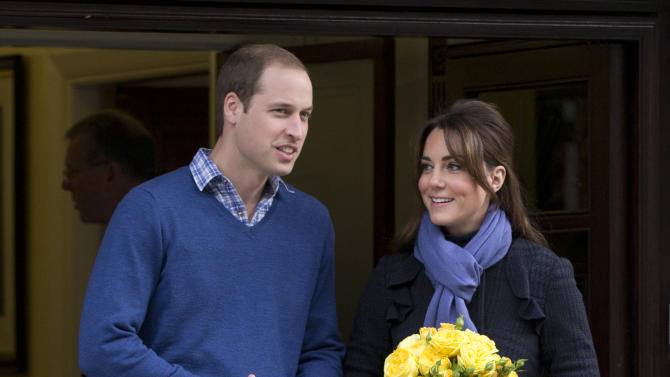 Britain's Prince William stands next to his wife Kate, Duchess of Cambridge as she leaves the King Edward VII hospital in central London, Thursday, Dec. 6, 2012. Prince William and his wife Kate are expecting their first child, and the Duchess of Cambridge has been admitted to hospital suffering from a severe form of morning sickness in the early stages of her pregnancy.  (AP Photo/Alastair Grant)