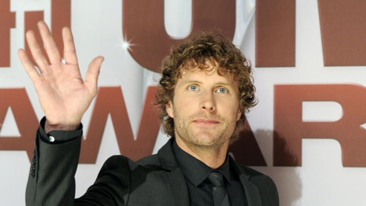 "FILE - A Nov. 9, 2011 file photo shows country singer Dierks Bentley at the 45th Annual CMA Awards in Nashville, Tenn.  Bentley is releasing a new four-song EP called ""Country & Cold Cans"" even while his last album continues to chart hit singles.   (AP Photo/Evan Agostini, file)"