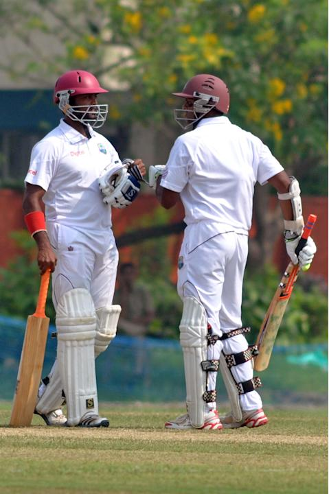 West Indies players N Deonarine and S Chanderpaul in action during Day 2 of practice match between West Indies and Uttar Pradesh Cricket Association XI at the Jadavpur University Ground in Kolkata on