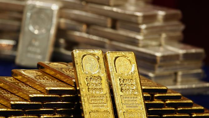 One-kg 24K gold and silver bars are displayed at the Chinese Gold and Silver Exchange Society in Hong Kong
