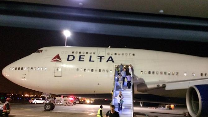 """In this photo provided by Michael Simon, a New York-bound Delta Air Lines plane is seen at Ben Gurion Airport in Tel Aviv, Israel, after an emergency Sunday, July 13, 2014. The flight returned safely to Tel Aviv about two hours after it left for John F. Kennedy International Airport in New York after flaps on the jumbo jet failed to retract properly on takeoff, the airline said. Delta spokeswoman Jennifer Martin said the crew made the emergency landing """"out of an abundance of caution."""" (AP Photo/Michael Simon)"""