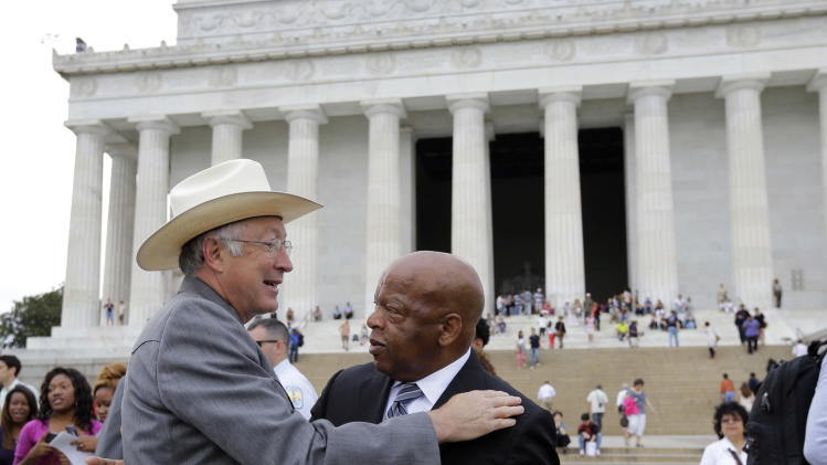 Secretary of the Interior Ken Salazar, left, greets Rep. John Lewis, D-Ga., after at an event sponsored by the National Endowment for the Humanities and Howard University to commemorate the 150th anniversary of Abraham Lincoln's preliminary Emancipation Proclamation, on the steps of the Lincoln Memorial Monday, Sept. 17, 2012, in Washington. (AP Photo/Alex Brandon)