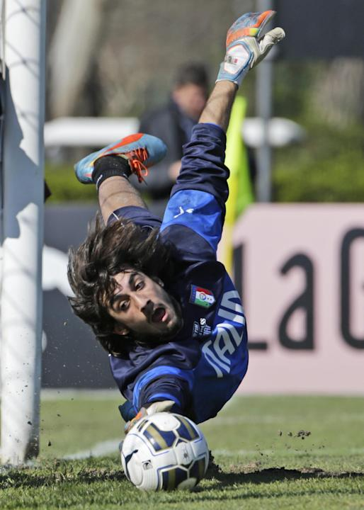 Goalkeeper Mattia Perin reaches for the ball during a training session, in Rome, Wednesday, March 12, 2014. With three months to go before the World Cup in Brazil, coach Cesare Prandelli called up a g
