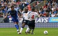 Chelsea's Frank Lampard, left, scores his third goal against Bolton Wanderers during their English Premier League soccer match in Bolton, England, Sunday Oct. 2, 2011. (AP Photo/Tim Hales)