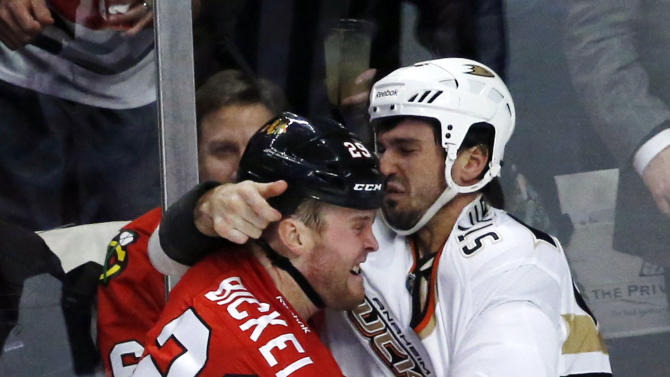 Chicago Blackhawks left wing Bryan Bickell (29) and Anaheim Ducks right wing Brad Staubitz fight during the second period of an NHL hockey game, Tuesday, Feb. 12, 2013, in Chicago. (AP Photo/Charlie Arbogast)