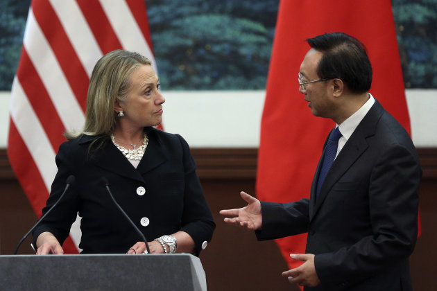 Chinese Foreign Minister Yang Jiechi, right, talks with U.S. Secretary of State Hillary Rodham Clinton after attending the press conference at the Great Hall of the People in Beijing, China Wednesday, Sept. 5, 2012. (AP Photo/Feng Li, Pool)