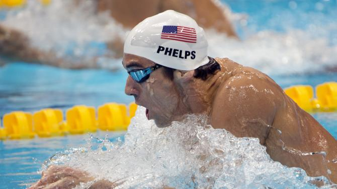 United States' Michael Phelps competes in a men's 200-meter individual medley heat at the Aquatics Centre at the Olympic Park during the 2012 Summer Olympics in London, Wednesday, Aug. 1, 2012.  (AP Photo/The Canadian Press, Ryan Remiorz)