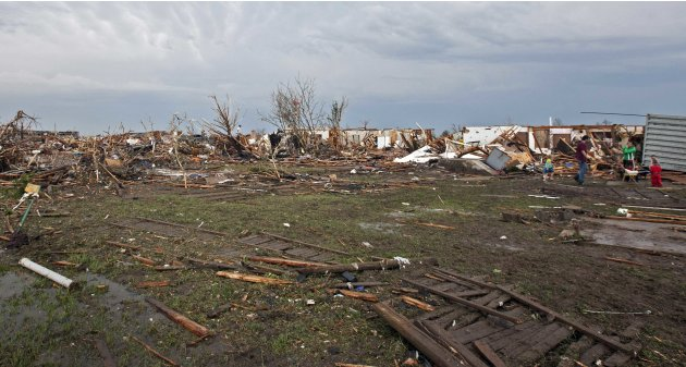 Stripped trees and destroyed houses remain after a huge tornado struck Moore, Oklahoma