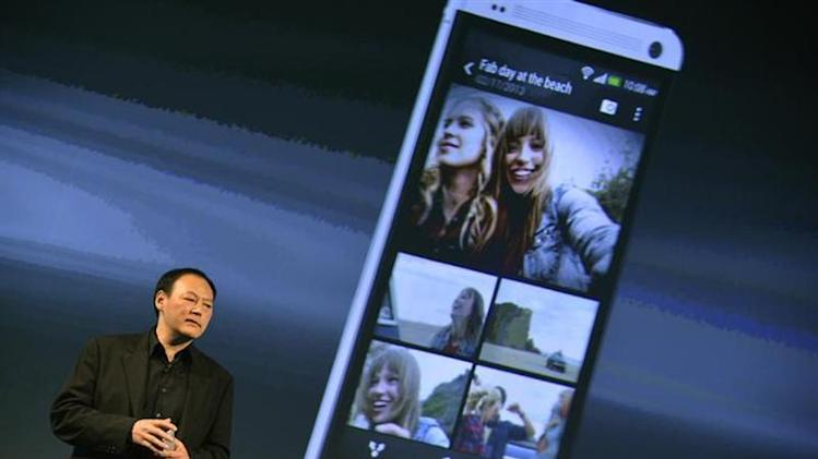 HTC CEO, Peter Chou, speaks during the launch of the HTC One smartphone in London February 19, 2013. REUTERS/Toby Melville/Files