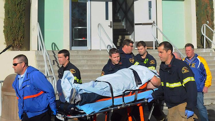 This image provided by the Taft Midway Driller/Doug Keeler shows paramedics transporting a student wounded during a shooting Thursday Jan. 10, 2013 at San Joaquin Valley high school in Taft, Calif. Authorities said a student was shot and wounded and another student was taken into custody. (AP Photo/Taft  Midway Driller, Doug Keeler)  MANDATORY CREDIT