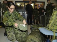 Lieutenant Alayna Kang of a Disaster Assistance Response Team (DART) prepares her luggage for a rapid deployment to the Philippine Islands on November 11, 2013. THE CANADIAN PRESS/HO, Canadian Forces Combat Camera - Corporal Darcy Lefebvre